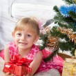 Little girl at a Christmas fir-tree — Stock Photo #7849386