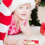 Little girl at a Christmas fir-tree — Stock Photo #7849392