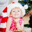 Little girl at a Christmas fir-tree — 图库照片