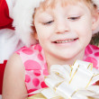 Little girl at a Christmas fir-tree — Stock Photo #7849401