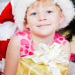 Little girl at a Christmas fir-tree — Stock Photo #7849404