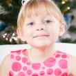 Little girl at a Christmas fir-tree — Stock Photo #7849408