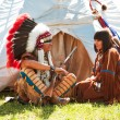 Group of North American Indians about a wigwam — Stock Photo