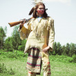 North American Indian in full dress - Stock Photo