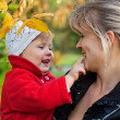 Mum with the daughter walk in autumn park — Stock Photo