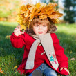 Beautiful little girl on walk in autumn park — Stock Photo #7947675
