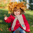Beautiful little girl on walk in autumn park — Stock Photo #7947681