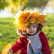 Beautiful little girl on walk in autumn park — Stock Photo #7947686