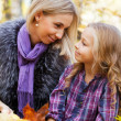 Happy mum and the daughter play autumn park — Stock Photo