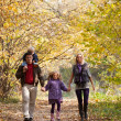 Family Enjoying Walk In Park - Stockfoto