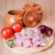 Cut meat and the vegetables, prepared for suppression in pots. — Stock Photo