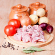 Cut meat and the vegetables, prepared for suppression in pots. - Stock Photo