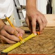 Worker Measuring Plywood — Stock Photo