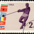 Athlete with hammer on post stamp — Stock Photo