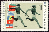 Relay race on post stamp — Stock Photo