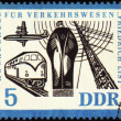 Stock Photo: Ship, airplane, train and radio-mast on post stamp