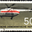 Flying helicopter Mi-8 on post stamp — ストック写真