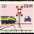 Post stamp with car on a railway crossing — Stock Photo
