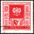 Arms of cities in Poland on post stamp - Stock Photo