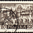 Medieval town of Warsaw on post stamp - Stock Photo