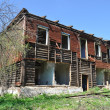 Old destroyed two-storeyed wooden house - Stock Photo
