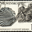 Royalty-Free Stock Photo: Mountains and mollusc fossil on post stamp