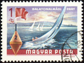 Yacht at Balaton lake on post stamp — Stock Photo