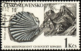 Mountains and mollusc fossil on post stamp — Stock Photo