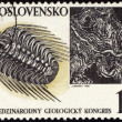 Mountains and fossil on post stamp — Stock Photo
