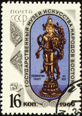 Statuette of Bodhisattva on post stamp — Stock Photo