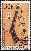 Tomahawk of American indian on post stamp — Stock Photo