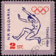 Broad jump on post stamp — Stock Photo