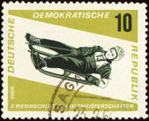 Descent to sledge on post stamp — Stock Photo