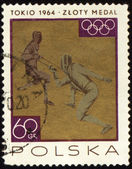 Two fighting fencers on post stamp — Stock Photo