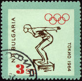 Jumping swimmer on post stamp — Stock Photo