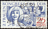 Portrait of young woman on post stamp — Stock Photo