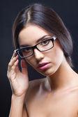 Attractive brunette girl wearing glasses — Stock Photo