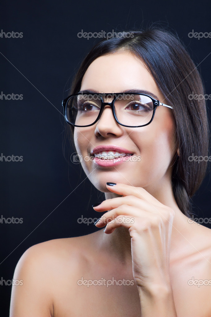 Funny young girl with stylish glasses and teeth braces — Stock Photo #7519904