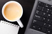 Laptop with coffee — Stock Photo