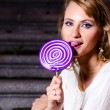 Fashionable woman with huge lollipop — Stock Photo