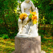 Sculpture at autumn park — Stock Photo