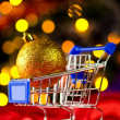 Royalty-Free Stock Photo: Shopping cart with decorative ball