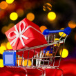 Shopping cart with decorative ball — Stock Photo #7253697