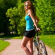 Woman with bicycle — Stockfoto