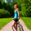 Woman with bicycle — Stock fotografie