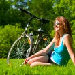 Woman and bike — Stock fotografie