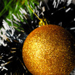 Golden ball on christmas tree — Stock Photo