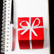 Gift box with notepad — Stock Photo