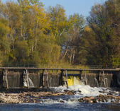 Dam on a small river — Stock Photo