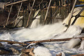 Water spills over the dam — Stock Photo